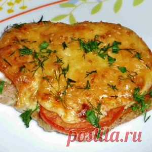 Meat in a foil with mushrooms and tomatoes