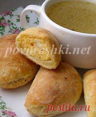 Friable pies with an egg stuffing to broth - culinary recipes of the Scullion with a serving spoon