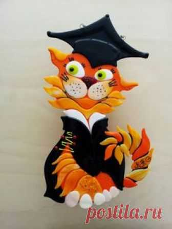 Graduating cat from fused glass