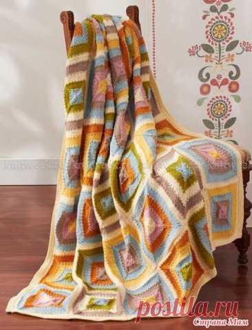 Идеи для утилизации остатков. Пледы с геометрическим узором  Дизайн Patons Design Studio Великолепное, нежное и красочное одеяло, связанное на спицах. Одеяло состоит из отдельных мотивов, связанных в различной цветовой гамме. Вязание каждого мотива выполняется из центра.   Размеры квадрат со сторонй 148 см Материалы Пряжа Patons® Decor™ (75% акрил, 25% шерсть, 100 г/190 м) Цвет А (белый) - 3 мотка Цвет В (светло-коричневый) - 2 мотка Цвет С (голубой) - 3 мотка Цвет D (зеле...