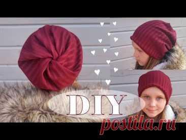 Шапка бини из прямоугольника ткани с необычной макушкой  (или как ее еще называют, шапка носок) - довольно универсальный унисекс аксессуар. В зависимости от выбранной ткани, она подойдет и мужчине и женщине и ребенку. Без выкройки. Очень быстро и просто! Эту шапку лучше всего делать из легкого трикотажа, она подойдет для прохладной весенне-осенней поры. Делюсь с вами вторым своим любимым вариантом шитья шапочки бини. Первый вариант двухсторонней шапки https://youtu.be/K5349sMyYR4