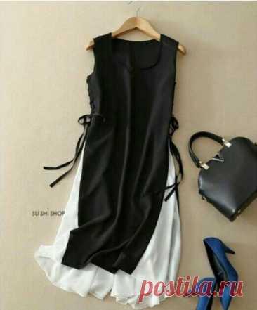 El patrón del vestido de la túnica la ropa A la moda y el diseño del interior por las manos