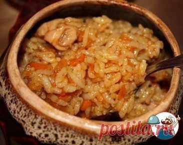 """""""Куриный плов в горшочках""""  Ингредиенты: - 1 куриный окорочок - 1 морковь - 1 головка репчатого лука - 6 ст.л. риса - соль по вкусу - масло растительное - приправа для курицы  Приготовление: 1. Окорочок помыть, разрезать на кусочки, натереть специями для курицы. В сковороду налить растительное масло, выложить окорочка, поставить на огонь тушиться. 2. Морковь натереть на крупной терке и добавить к окорочкам. Репчатый лук мелко порезать и высыпать в сковороду. Тушить до гото..."""