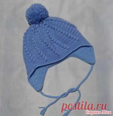 голубая шапочка с подкладом и с ушками крючком.