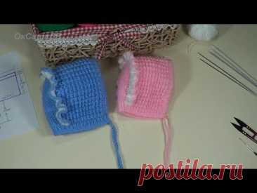Children's hat (cap) with a ruche. Knitting by spokes. Children's knitted cap.