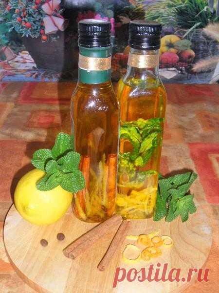Купажное оливковое масло с лимоном, апельсином и корицей и лимонное с мятой.