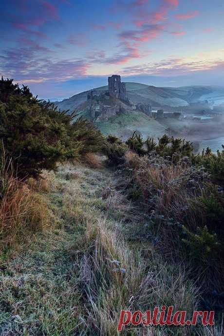 Close your eyes and dream of England  A rather stunning and fantastical view ofCorfe Castle in the winter sunlight. The Castle is a fortification built by His AncientnessWilliam the Conqueror during the eleventh century; and stands...
