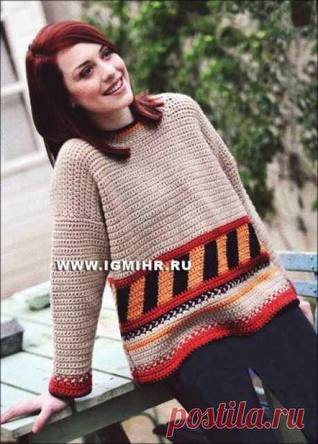 Теплый пуловер свободного кроя, с красивым узором из разноцветных полос в стиле индейцев навахо. Крючок