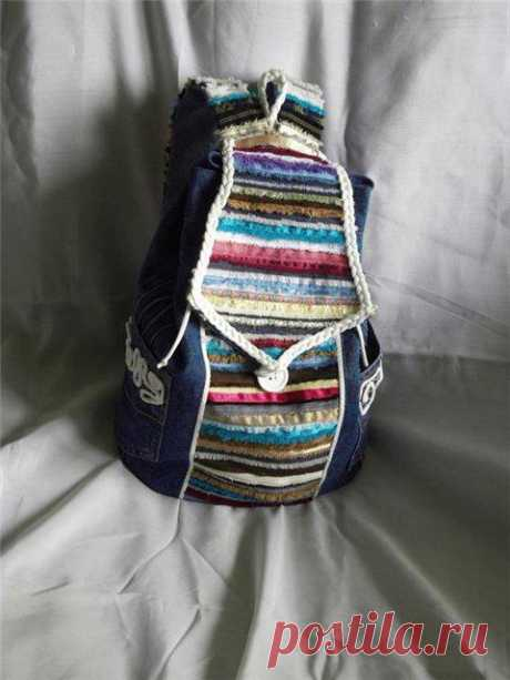 We sew a backpack from old jeans and edges of fabric.