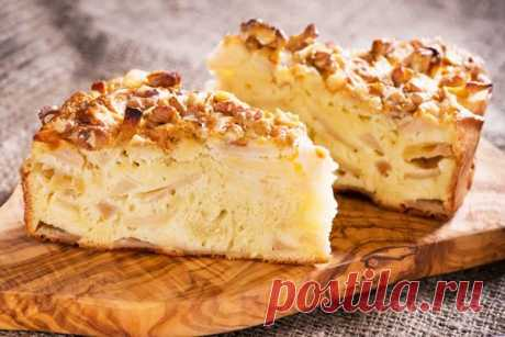 The classical recipe of a charlotte with apples in an oven with walnuts