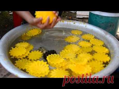 Wax flower makers add colour to the festival at That Laung