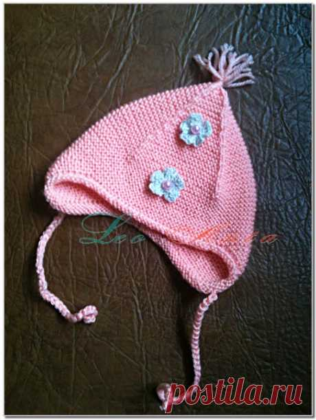 Hat pink GARTER EAR. A hat for the child about one year.