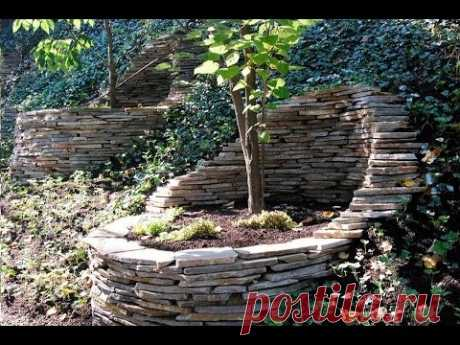 Use of a stone in landscaping. Ideas for giving and a garden.