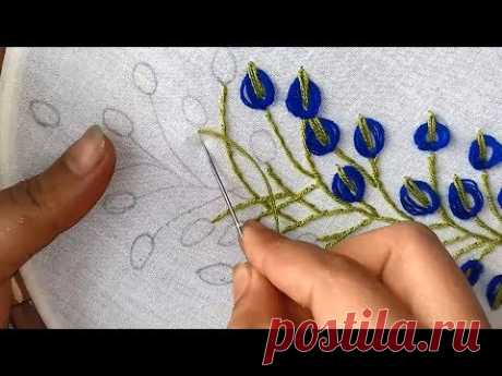 Hand Embroidery:  embroidery design with lazy daisy stitch.
