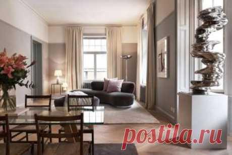 Изысканный современный скандинавский интерьер Эта квартира в Стокгольме отличается от типичных шведских квартир, о которых мы пишем, большей изысканностью и теплой цветовой гаммой. В гостиной дизайнерский диван довольно необычной формы (редко так...