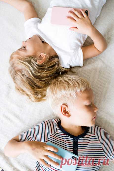 Kids sleeping with their phones on their ches.. | Royalty free stock photo - 538874