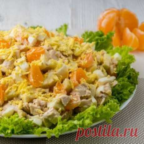 Amazingly Tasty Tangerines and Chicken Salad. Light New Year's Salad on the Holiday Table Bright and beautiful and amazingly tasty...