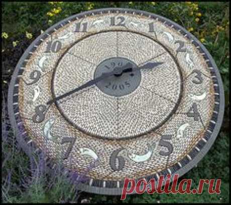 Cobble Clock, by Maggy Howarth at Lowther Gardens, Lytham, Lancashire, UK. www.maggyhowarth.co.uk
