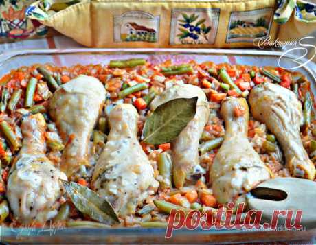 The chicken legs baked with rice and vegetables