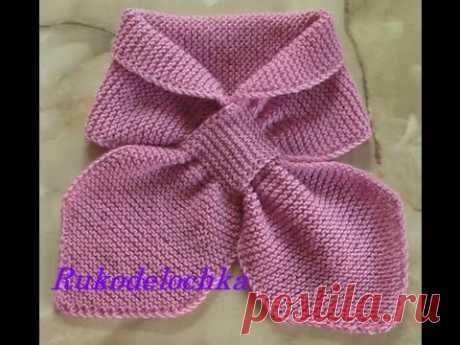 Scarf with a double loop. Knitting on spokes.