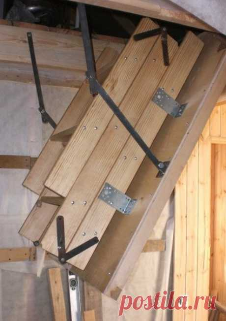 Step-ladder on an attic the hands