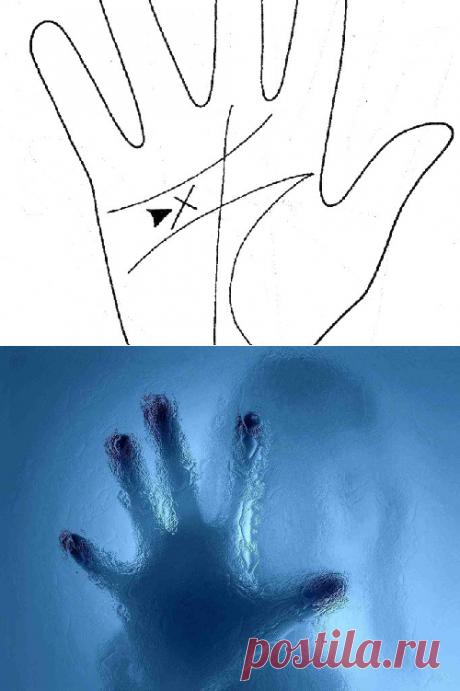 Chiromancy: a mystical cross on a palm