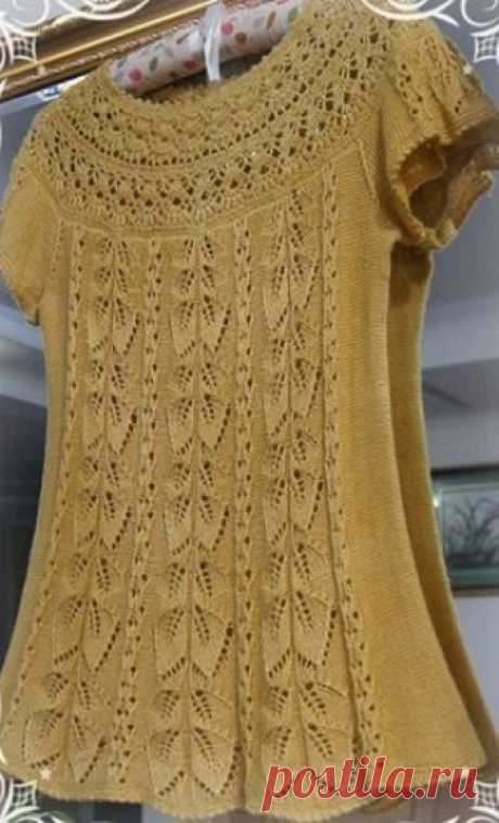 Knitting of a tunic the Summer tunic is connected with the round coquette from a yarn of mustard color by spokes and a hook. The round coquette of a tunic is connected by a hook. Other part of a tunic, including sleeves is connected by spokes.