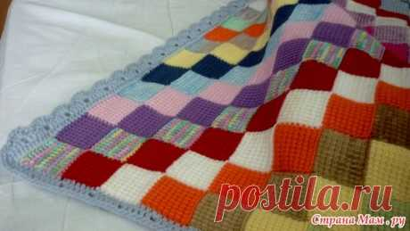 Plaid a hook in technology of the Tunisian knitting. Enterlak from a corner