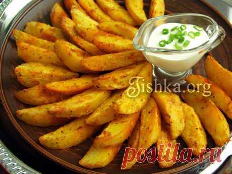 Картошка по-деревенски в духовке Рецепт вкуснейшей домашней картошки по-деревенски без кожуры в духовке. Хрустящая снаружи, мягкая внутри. Подбор специй для картофеля. Ингредиенты: 1.3 кг