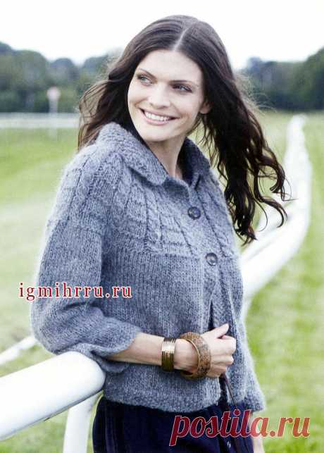 Cozy warm jacket of gray color, with a round collar. Spokes