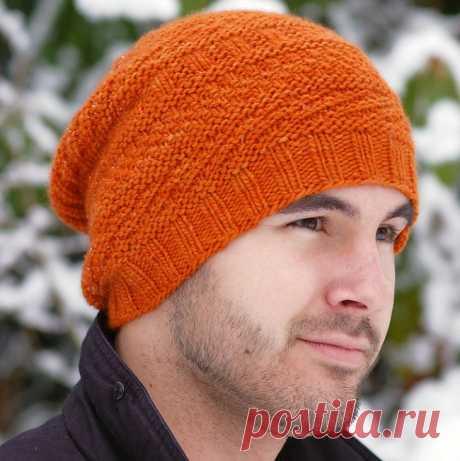 Вязаная мужская шапка спицами от Stephen West Обычно, если нужно связать мужскую шапку спицами, всегда встаёт вопрос о выборе подходящей модели. Ведь мужская шапка спицами должна быть достаточно лаконичной, немного брутальной, но в то же время нескучной.  Конечно, в крайнем случае связать мужскую шапку можно и традиционной резинкой, но ведь хочется создать своими руками не просто тёплый головной убор, а стильную, запоминающуюся вещь.  Интересная вязаная мужская шапка получ...
