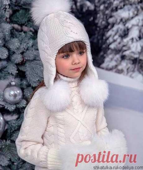 Шапка с длинными ушками Шапка с длинными ушками спицами. Модная шапка для девочкиспицами крупной вязки с косами.
