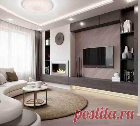 Стильный интерьер гостиной выполненный в серых тонах.