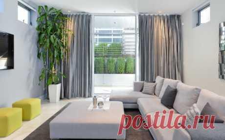 Серый угловой диван как иконический элемент интерьера   Роскошь и уют