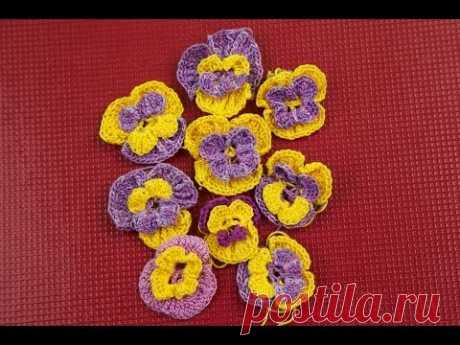 Knitting by a hook. Flowers pansies