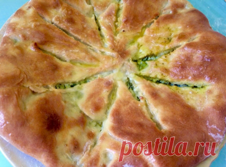 Осетинский пирог с творожно — сырной начинкой и зеленью.