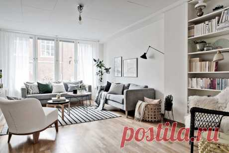 Скандинавская квартира с акцентной стеной на кухне