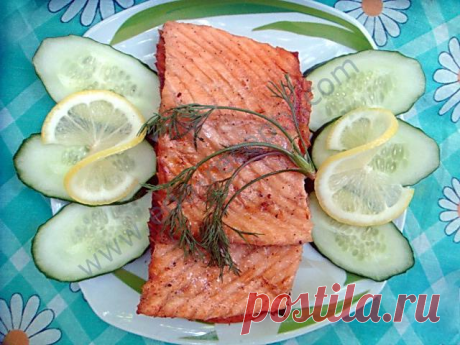 Salmon on a grill on a fire