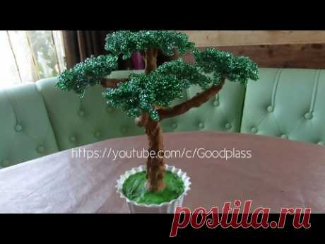 Tree a bonsai from beads. Weaving by beads.