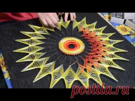Процесc создания картины в технике string art.