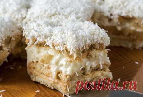 Торт «Рафаэлло»без выпечки— это невероятно нежный и вкусный десерт на праздничный стол. Ингредиенты: - Печенье (Юбилейное) — 300 г - Масло сливочное (или маргарин) — 100 г - Молоко сгущенное — 200 мл - Кокосовая стружка — 50 г - Корица — 1 ст. л. 1. Размягчённое масло смешайте со сгущенным молоком и взбейте миксером. 2. Печенье поломайте на маленькие кусочки и добавьте в крем вместе с корицей и кокосовой стружкой. 3. Массу тщательно перемешайте, выложите в форму и поставьте в холодильник на …