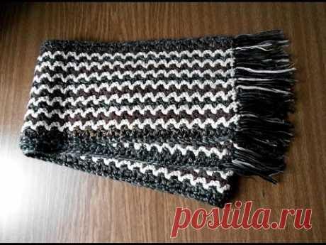 """Шарф, связанный крючком из нитей разного цвета. Начинается вязание с цепочки воздушных петель - это длина шарфа. Затем вяжется узор """"галочка"""" из двух столбик..."""