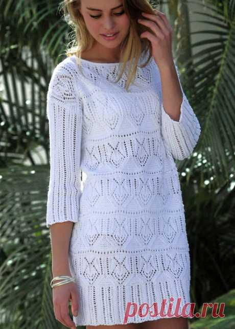 White dress with an openwork pattern