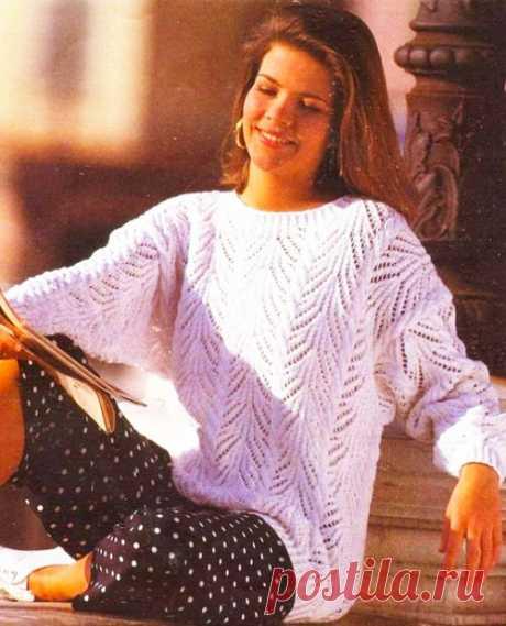 Женский пуловер с ажурным узором и косами Восторг ангела – описание вязания спицами со схемой