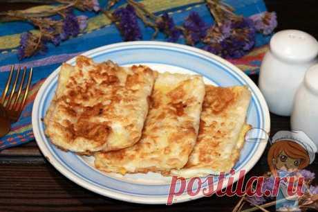 Завтрак из лаваша с овощами на сковороде. Рецепт из серии за 5 мин! Приготовим завтрак из лаваша с овощами и сыром. Вкусный сытный завтрак из тонкого лаваша приготовить легко и просто. Хрустящая основа отлично сочетается с сочной начинкой.