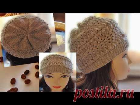 Осінньо-весняна шапочка з ажурним узором.Una gorra con un patrón calado.