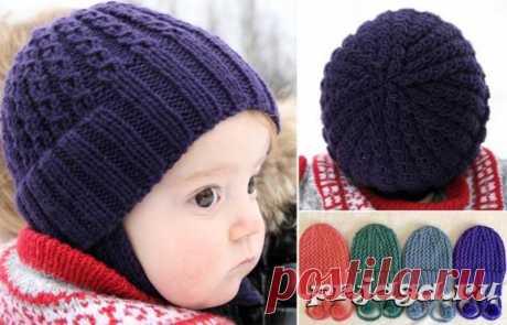 Детская шапка спицами узором обвитых петель
