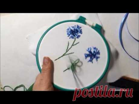 The cornflower embroidered with satin ribbons.