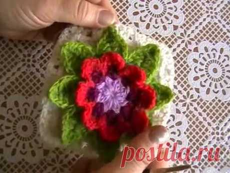 Knitting by a hook. Motive with a volume flower and leaflets.