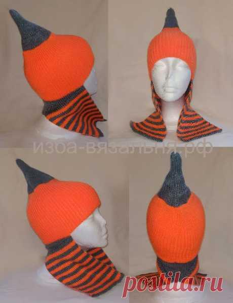 Осенняя или зимняя шапочка  с ушками, которые могут выполнять функцию шарфа